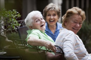 Two older adults with daughter enjoying time together in Naples, Florida